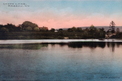 Historical Lyons Lake Postcard Hand colored B&W photograph View across lake from camps Shows Boarding House and Farm House before dance hall, ice shed (boat house) or pavilion Not Dated