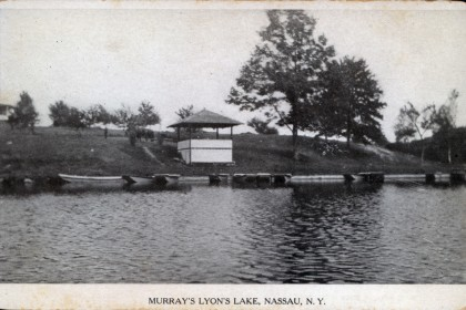 Historical Lyons Lake Postcard B&W photograph View of Murray's (from camps) Shows ice shed (now boat house) & boats Not Dated